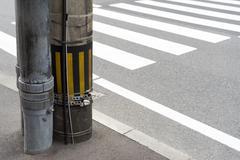 Stock Photo of electricity post in japan beside a crosswalk
