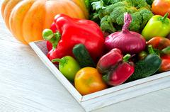 Assortment of fresh vegetables on wooden table - stock photo