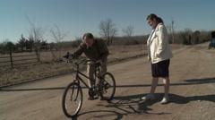 Dad Fixing Daughters Bike Stock Footage