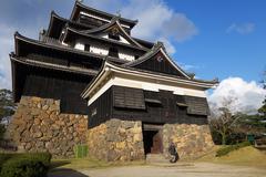 tourist visits matsue samurai feudal castle in shimane prefecture - stock photo