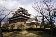 tourists visit matsue samurai feudal castle in shimane prefecture - stock photo