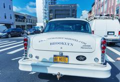 Stock Photo of brooklyn - jun 12, 2013: vintage white taxi cabs await customers. today, more