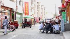 Chinese men play mahjong in Jiayuguan, China Stock Footage