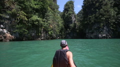 Man rowing kayak in the canyon Stock Footage