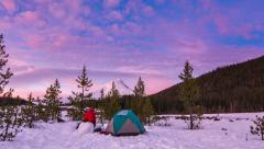 Man Moving About Snow Camp, Taking Pictures During Sunset. Stock Footage