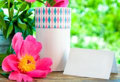 gift and card for letter in garden - stock photo