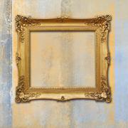 Baroque golden frame on a grunge faded texture Stock Photos