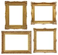 Four golden baroque empty frames isolated in white Stock Photos