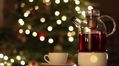 Glass teapot against Christmas background HD Stock Footage