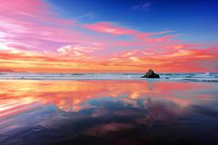 sopelana beach at sunset with clouds reflections - stock photo