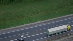 Aerial tracking shot with cargo truck on a highway UHD 4K Stock Footage