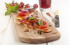 flat bread pizza with tomato - stock photo