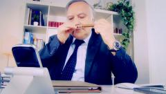 Funny business man trying to relax receiving bad phone call Stock Footage