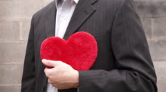 Man Holding a Red Fuzzy Heart - stock footage