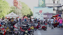 Scooters, bicycles at  chinese market in Jiayuguan, China - stock footage