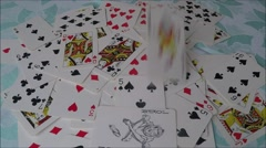 Mixed playing cards on the table Stock Footage