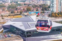 London - aug 24: visitors travel on the emirates cable car. the service is lo Stock Photos