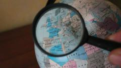 Globe and magnifying glass - stock footage