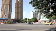 Busy roundabout in Jiayuguan, China - stock footage