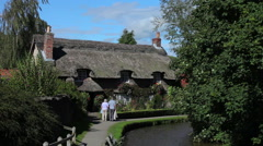 THATCHED COTTAGE BY RIVER, THORNTON-LE-DALE, NORTH YORKSHIRE Stock Footage