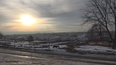 Beautiful village panorama winter day rustic covered snow sunset sunrise misty Stock Footage