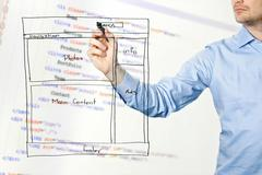 Designer presents website development wireframe Stock Photos