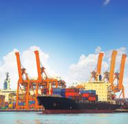 Commercial ship and cargo container on port use for import export and freight Stock Photos