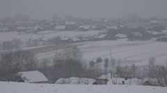 Pan right rural village covered snow blizzard snow storm peaceful place rustic  Stock Footage