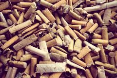 closeup shot of burnt cigarette butts - stock photo