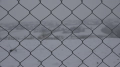 Mountain village wire fence net blizzard winter day peaceful resort holiday xmas Stock Footage