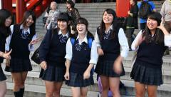 Group of Young Japanese high school student girls smiling in Tokyo, Japan Stock Footage