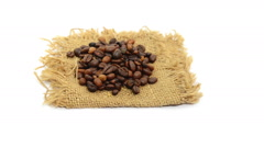 Coffee beans and sack rotate on white background Stock Footage