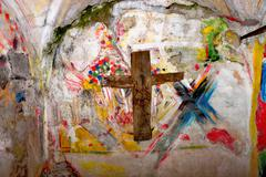 Religious paintings in little chapel Stock Photos