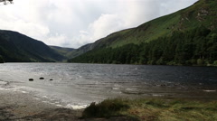 Upper Lake after rain in Glendalough Stock Footage