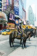 new york, usa - june 11: police officer rides his horse downtown in new york  - stock photo