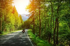 Biker on mountainous road Stock Photos