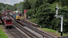 ROYAL SCOTS GREY & SOUTHERN 825 STEAM ENGINE, GOATHLAND, NORTH YORKSHIRE Stock Footage