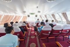 passengers on board of hydrofoil from saigon to vungtau - stock photo
