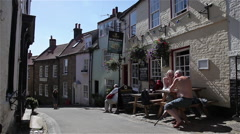 YE DOLPHIN PUBLIC HOUSE, ROBIN HOOD'S BAY, NORTH YORKSHIRE Stock Footage