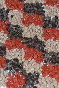 Several brown plastic granulates - stock photo