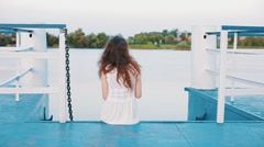 Girl is seating on the berth - stock footage