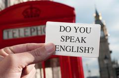 Do you speak english? in a signboard with the big ben in the background Kuvituskuvat