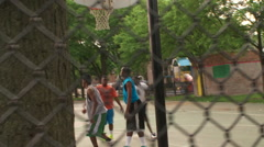 Street basketball layup, fence steadicam Stock Footage