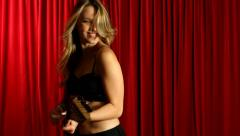 Sexy female guitarist playing electric guitar on stage Stock Footage