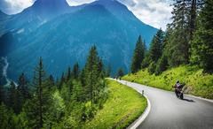 motorcyclists in mountainous touring - stock photo