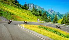 Motorbikers group in mountainous tour Stock Photos