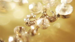 Diamond earrings. Gold. Smooth focus shifting, macro - stock footage
