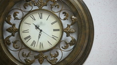 Old antique clock on the wall Stock Footage