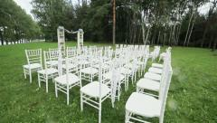 Rows of chairs on lawn ready for outdoor wedding ceremony. Steadicam - stock footage