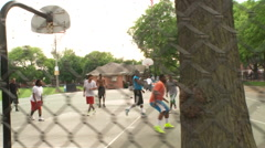 Street basketball jumpshot, fence steadicam Stock Footage